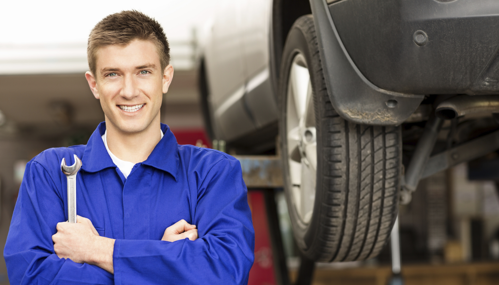 Happy Car Mechanic Holding Wrench